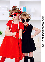 pin-up little girls - Two funny little girls with curlers in...