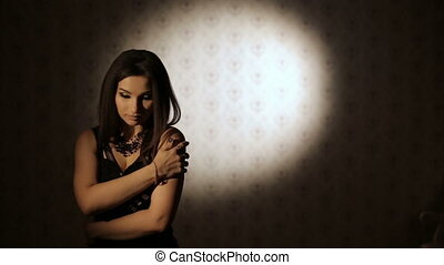 Sad Woman in a dark room