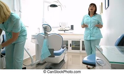 Dentist and nurse in the dental office - Dentist and nurse...