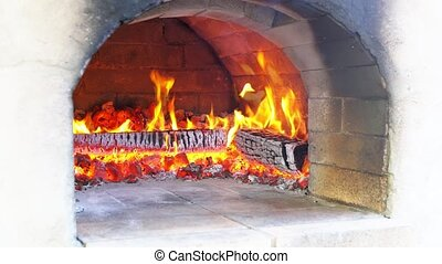 Pizza being baked in traditional wood burning pizza-bread...