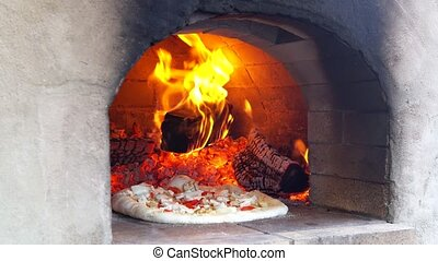 Pizza Baking Wood Fired Oven - Pizza Baking in Wood Fired...