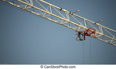 Construction site crane against blu sky