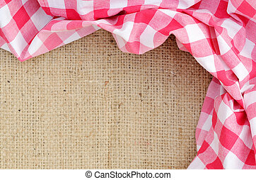 Red folded checkered rural tablecloth over canvas - frame