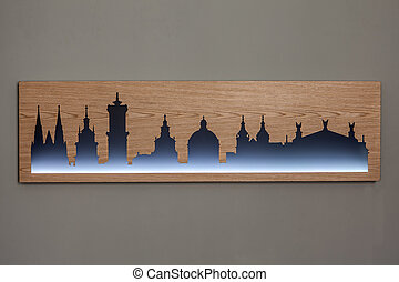 Cityline of Lviv old city carved in wood with light -...
