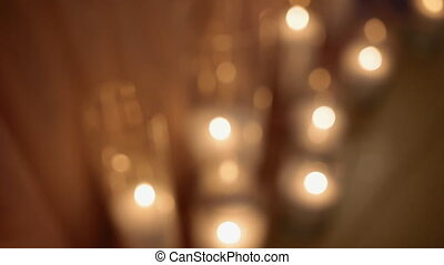 Table decorated with candles. Soft light of night.