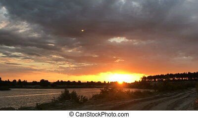 dramatic sunset on the river - dramatic summer sunset on the...