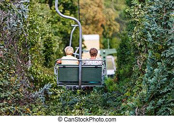 Elderly women on chairlift - Photo of elderly women on...