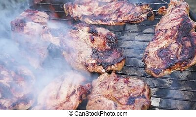 BBQ with meat steaks - grilling meat, returning on the new...