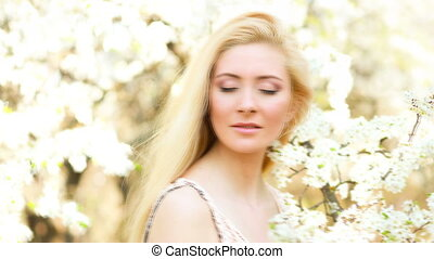 Beautiful Young Woman at Blossom outdoor. Video from photo...