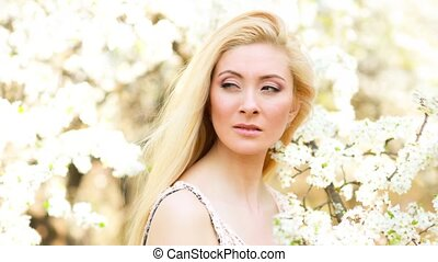 Beautiful Young Woman at Blossom outdoor. - Woman,portrait...