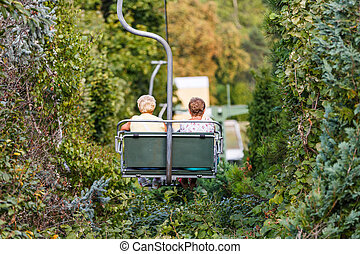 Elderly women on chairlift - Photo of elderly women on...