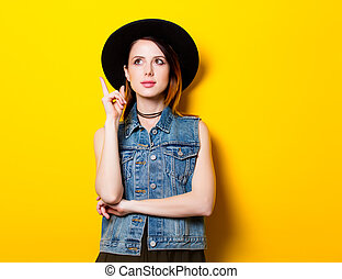 Portrait of young adult woman in hat