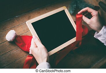 hands wrapping christmas board and gifts - Young woman hands...