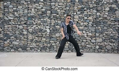 Young male hip-hop dancer dancing outside - Young male...