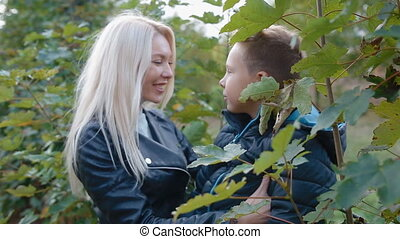 Mother and son touch each other with their noses. Happy...