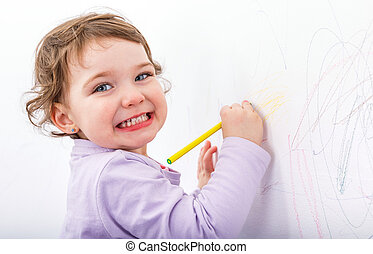 Adorable child drawing on the wall - Photo of adorable child...