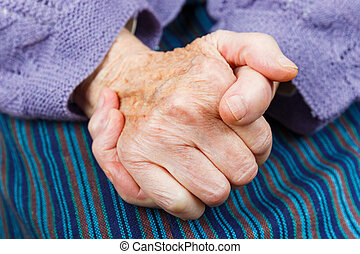 Elderly woman hands - Close up photo of clasped elderly...