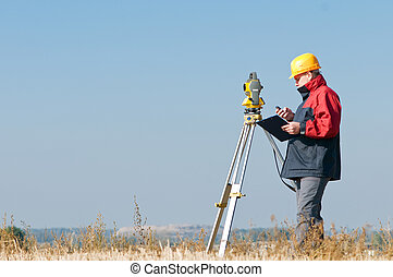 surveyor theodolite worker - Surveyor worker making...