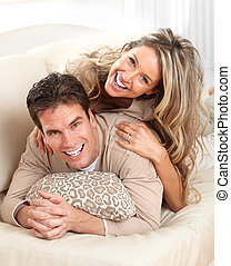 couple - Young happy couple in a bed at home
