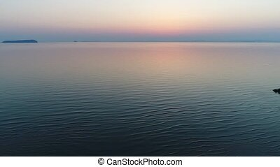 aerial drone flying calm ocean at sunset - Aerial view from...