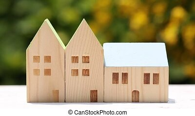 miniature model of house with flower background