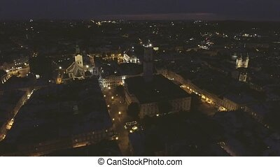 Flying over Night Old City Lviv, Ukraine.