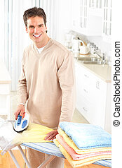 man ironing clothes - Happy young handsome man ironing...