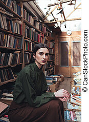 Portrait of girl in library looking camera - Portrait of...