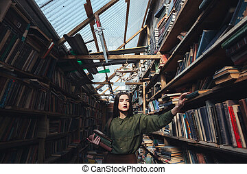 Girl with books looking camera - Brunette girl with books...