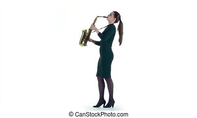 Woman plays on saxophone jazz melody. Slow motion, white...