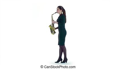 Jazz melody plays woman on saxophone. Slow motion, white...
