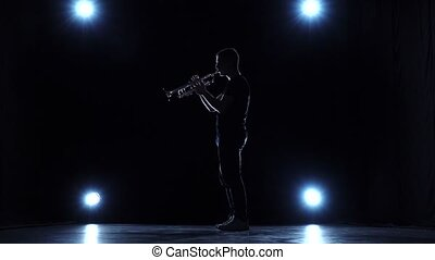 Trumpet jazz playing musician in studio with spotlights....