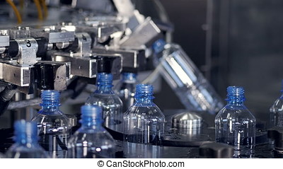 The process of bottled water production. Bottling, filling,...