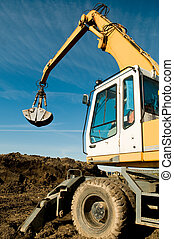 wheel loader excavator at work - excavator loader machine...