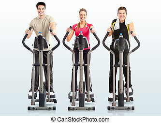 Gym & Fitness. Smiling woman and two men working out.