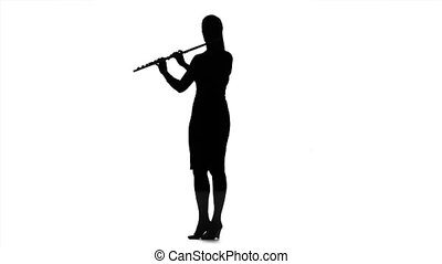 Girl playing on flute. Silhouette on white background, slow...