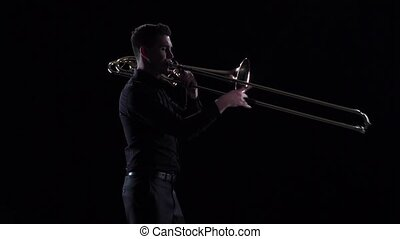 Man plays on wind instrument tranquil melody in slow motion...