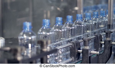 Plastic bottles transporting system at a modern industrial...