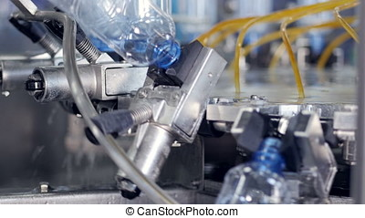 PET bottles being washed at bottled water plant. - The...