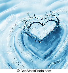 Heart from water splash with bubbles on blue water...