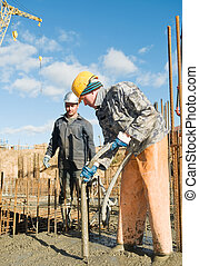 workers on concrete works - builder laborers works on...