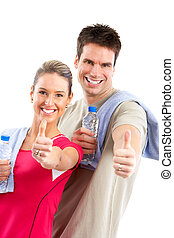 Fitness and gym Smiling young strong man and woman Isolated...