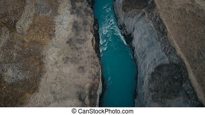 Aerial view of the waterfall Gullfoss in crevice. Copter...