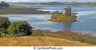 Castle Stalker is on an island on Loch linnhe, which is a...