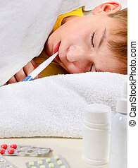 Sick Kid in the Bed - Sick Kid with Thermometer on the Bed