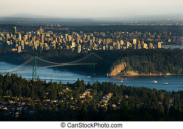Lions Gate Bridge and Downtown Vancouver - Boats pass...