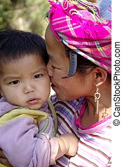 Motherly Love - A Black Hmong woman and baby