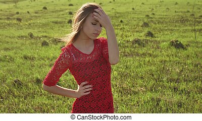 Girl wind nature. girl is standing in the field of green grass. Woman lifestyle freedom