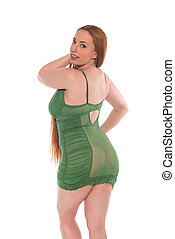 Redhead in green - Curvy young redhead in a green lace...