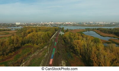 Aerial footage of railway and freight train - Flying over...